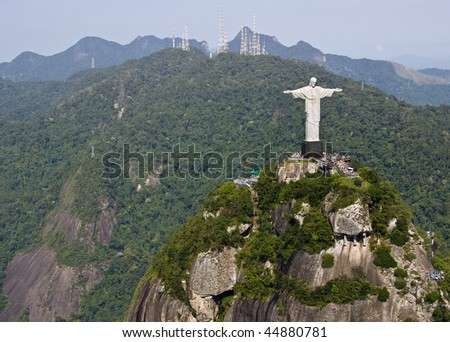 Dramatic aerial view of Christ The Redeemer Monument perched on Corcovado Mountain