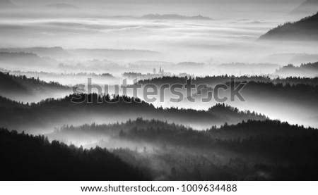Dramatic and foggy sunrise #1009634488