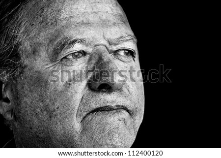 Dramatic and powerful black and white portrait of a senior man with pale eyes looking away great facial details, perfect for aging or other old age issues. #112400120