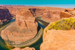 Dramatic and scenic Horseshoe Bend on Colorado River part of east rim Grand Canyon in Arizona, USA