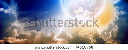 Dramatic background - impressive abstract sunset with planet in cloudy sky