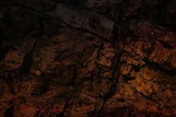 Dramatic background of an ancient cave. Scary dark stone basement wall. Fantasy abstract mine texture for 3d game design