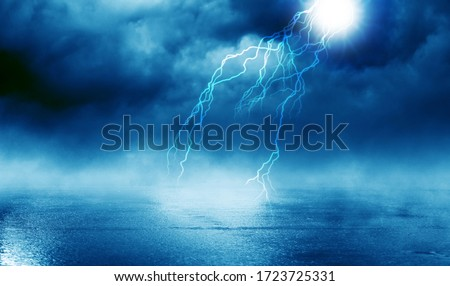 Photo of  Dramatic background of the night sky, thunderstorm, lightning. Smoke, fog, smog against the background of the city landscape.