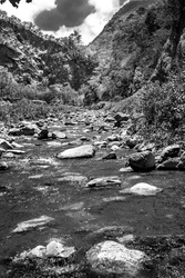 dramatic black and white image of rio Ocoa in the dominican republic mountains of the caribbean.