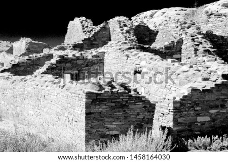 Dramatic black-and-white image of the ruins of Pueblo Bonito in Chaco Canyon, New Mexico. These rooms were build by prehistoric stone masons more than 800 years ago.