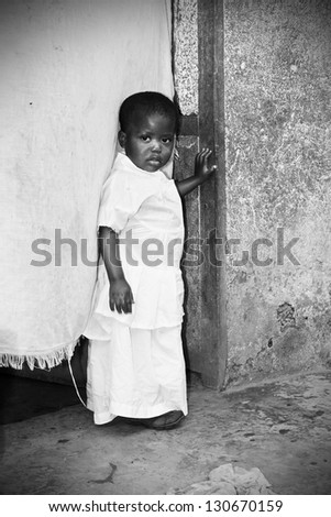 Dramatic black and white of African baby girl, poverty, third world