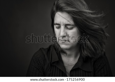 Dramatic black and white portrait of a very sad and lonely hispanic woman