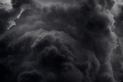 Dramatic black smoke from a fire.