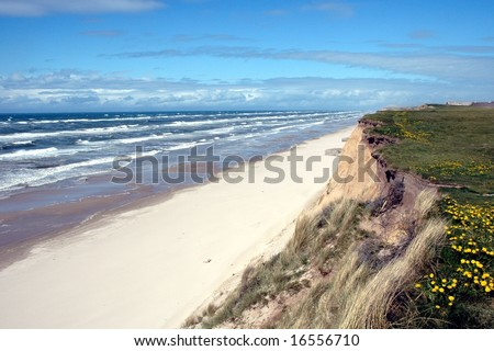 Dramatic braking waves at the West-coast of Jutland (Denmark) - stock photo