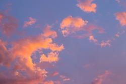 Dramatic, bright sky with Cumulus clouds before sunset, sunrise.