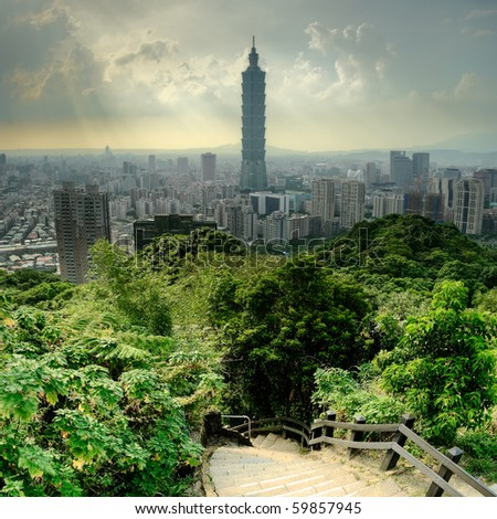 Dramatic cityscape of Taipei  and trees in park, Taiwan, Asia.