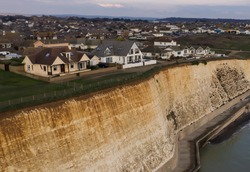 dramatic cliffs with houses built on the cliff edge