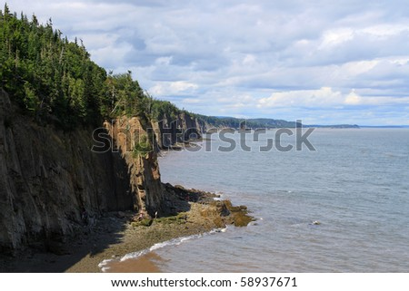 Dramatic cliifs of Cape Enrage along the Bay of Fundy, in New Brunswick, Canada