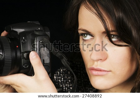 Dramatic Close-up of Female Photographer/Photo-Journalist w/SLR.