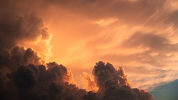 Dramatic clouds at sunset forming interesting shapes
