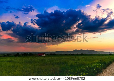 Dramatic clouds at the sunset #1089668702