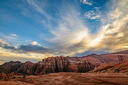 Dramatic clouds cover the sky over the mountains in Snow Canyon state park in St. George, Utah