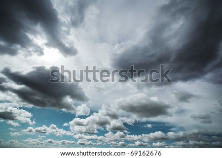 Dramatic clouds in sky background.