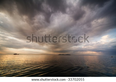 dramatic clouds over the sea on sunset