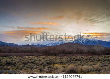 Dramatic clouds over the Sierra Nevada mountains. #1124099741