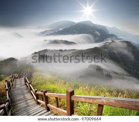 Dramatic clouds with mountain and tree #97009664