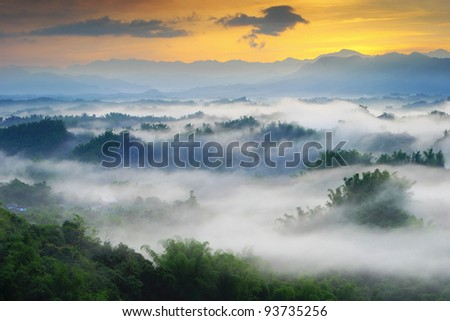 Dramatic clouds with mountain and tree in the morning shot in taiwan, asia