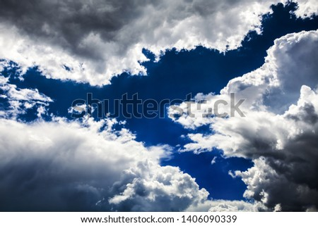 Dramatic Cloudscape Background with a Blue Sky #1406090339