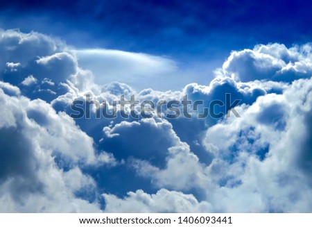 Dramatic Cloudscape Background with a Blue Sky #1406093441