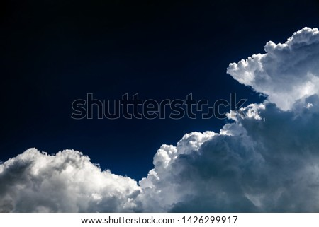 Dramatic Cloudscape Background with a Blue Sky #1426299917