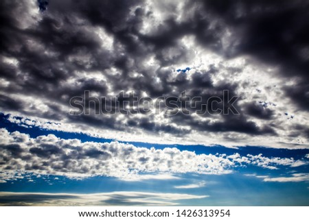 Dramatic Cloudscape Background with a Blue Sky #1426313954