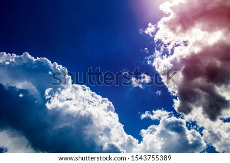 Dramatic Cloudscape Background with a Blue Sky #1543755389