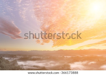 Dramatic cloudscape in morning with red clouds on sky and green mountain in countryside. #366173888