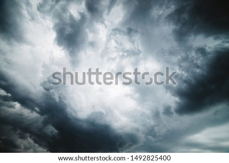 Dramatic cloudscape texture. Dark heavy thunderstorm clouds before rain. Overcast rainy bad weather. Storm warning. Natural gray background of cumulonimbus. Nature backdrop of stormy cloudy sky. #1492825400