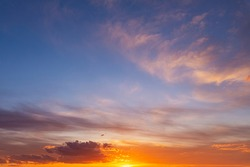 Dramatic colorful red orange to dark blue sunset or sunrise sky landscape clouds. Natural beautiful cloudscape dawn background wallpaper. Stormy windy nature twilight dusk scene panorama