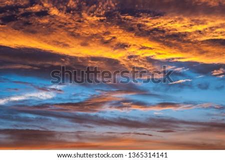 Dramatic colorful sunset and sunrise sky #1365314141