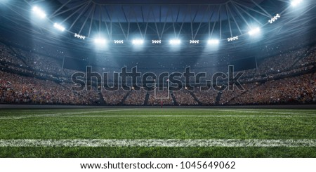 Dramatic 3D professional American football arena with green grass and rays of light #1045649062