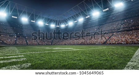 Dramatic 3D professional American football arena with green grass and rays of light #1045649065