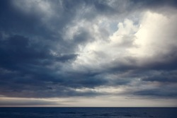 Dramatic dark cloudy sky over sea, natural photo background