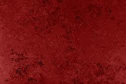 Dramatic dark red grunge seamless stone texture. Vine red venetian plaster background seamless stone grunge texture.