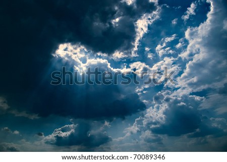 dramatic dark sky with clouds and light