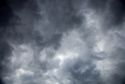 Dramatic dark sky with heavy overcast stormy clouds