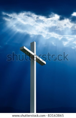 Dramatic deep blue Jesus light shining down on cross
