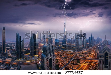 Dramatic Dubai sunset panoramic view of downtown with lightning storm. Dubai is super modern city of UAE, cosmopolitan megalopolis. Very high resolution image #1277729557