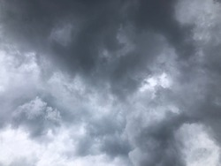 Dramatic dusk cloudy sky. Gloomy sky view. Dark overcast sky before to rainy. Black cloudy sky atmosphere.