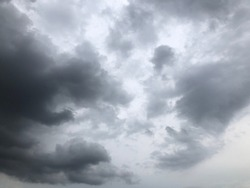 Dramatic dusk dark cloudy on rainy sky. Overcast sky atmosphere before to rain. Natural clouds sky background. Mystery with natural weather change. Cloudy sky.