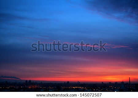 Stock Photo Dramatic evening cloudscape in city