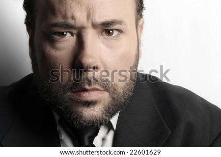 stock photo dramatic extreme close up of a very serious mature businessman in suit and tie against white 22601629 THREE TIME CHAMP: Ryan Gay won his second straight Maine Amateur ...