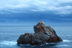 Dramatic featuring scenic rock formations,  seascape