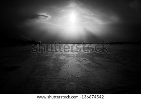 Dramatic frozen river landscape, black and white