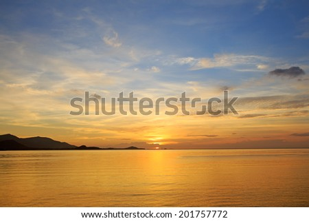 Dramatic golden beach sunset sky and tropical sea background